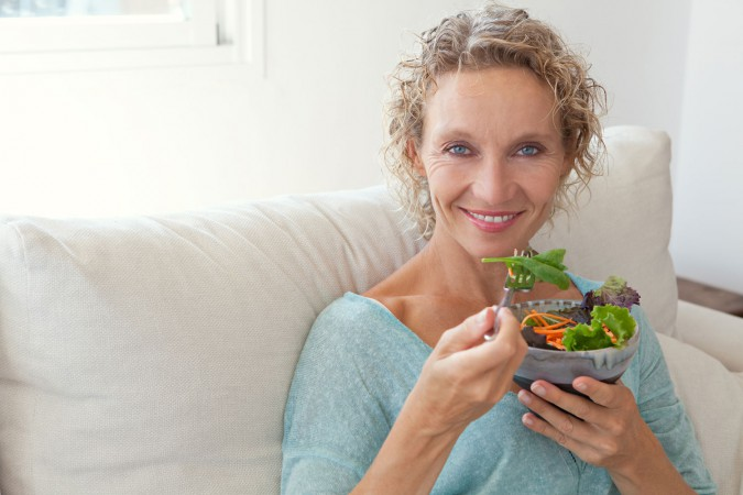 Mature woman eating healthily